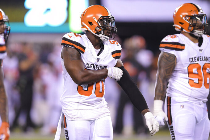 Cleveland Browns defensive end Chris Smith (50) lines up with teammates during the second half of an NFL football game against the New York Jets, Monday, Sept. 16, 2019, in East Rutherford, N.J. (AP Photo/Bill Kostroun)