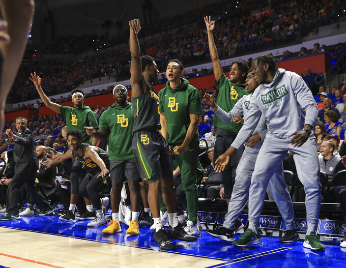 Baylor guard Devonte Bandoo (2) celebrates with teammates on the bench after scoring a three-point basket during the second half of an NCAA college basketball game against Florida, Saturday, Jan. 25, 2020, in Gainesville, Fla. (AP Photo/Matt Stamey)
