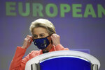 """FILE - in this file photo dated Wednesday, July 14, 2021, European Commission President Ursula von der Leyen puts on her protective facemask after a media conference at EU headquarters in Brussels.  European Union chief Ursula von der Leyen on Thursday July 22, 2021, has flatly refused to renegotiate a post-Brexit trade deal with the U.K. after a Prime Minister Boris Johnson urged the bloc to work with British officials to find """"practical solutions"""" to red tape and inspections that are causing shortages in Northern Ireland. (AP Photo/Valeria Mongelli, FILE)"""