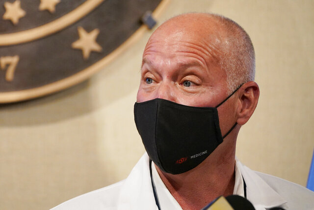 In this Monday, Nov. 16, 2020, photo, interim Oklahoma Health Commissioner Dr. Lance Frye speaks during a news conference in Oklahoma City. Concerning the coronavirus surge in Oklahoma, Frye said in a statement