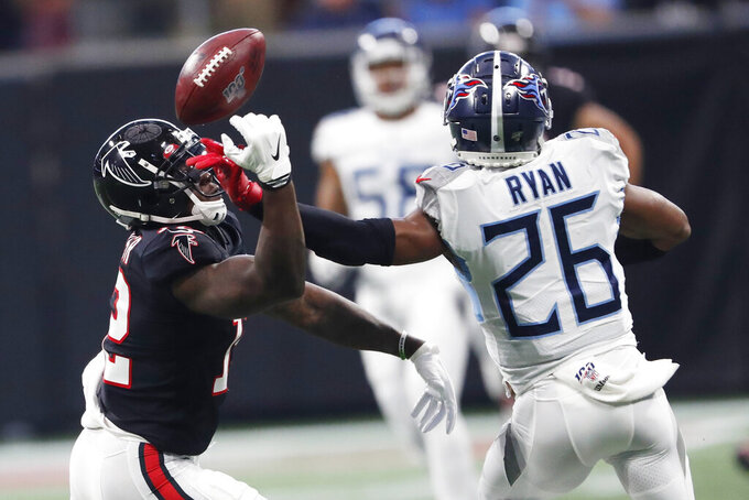 Atlanta Falcons wide receiver Mohamed Sanu (12) misses the catch against Tennessee Titans cornerback Logan Ryan (26) during the first half of an NFL football game, Sunday, Sept. 29, 2019, in Atlanta. (AP Photo/John Bazemore)