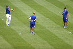 New York Mets pitchers Seth Lugo, left, and Daniel Zamora, right, stretch during a baseball workout at Citi Field in New York, Friday, July 3, 2020. (AP Photo/Adam Hunger)