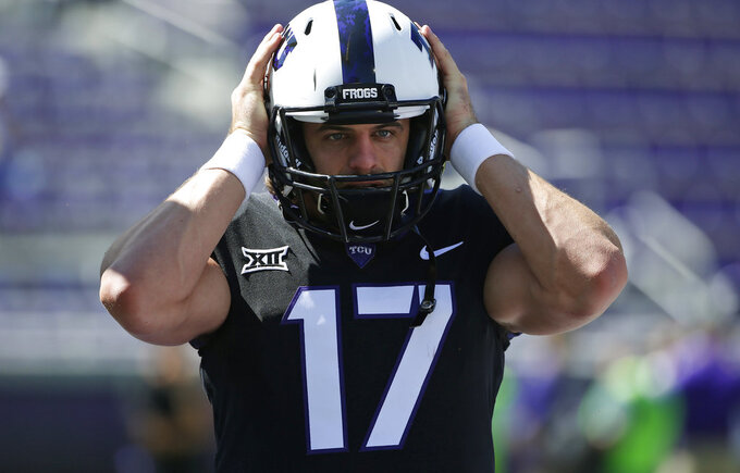FILE - In this Oct. 7, 2017, file photo, TCU quarterback Grayson Muehlstein (17) warms up before TCU played West Virginia in an NCAA college football game in Fort Worth, Texas. Injury-plagued TCU, which has gotten three of its wins when scoring fewer than 20 points, likely will have fifth-year senior Muehlstein making his first career start in his final regular season game Saturday night against Oklahoma State, when the Horned Frogs have to win to get bowl eligible. (AP Photo/Ron Jenkins, File)