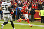 Kansas City Chiefs quarterback Patrick Mahomes (15) runs for a touchdown as Oakland Raiders safety Erik Harris (25) watches during the first half of an NFL football game in Kansas City, Mo., Sunday, Dec. 1, 2019. (AP Photo/Ed Zurga)