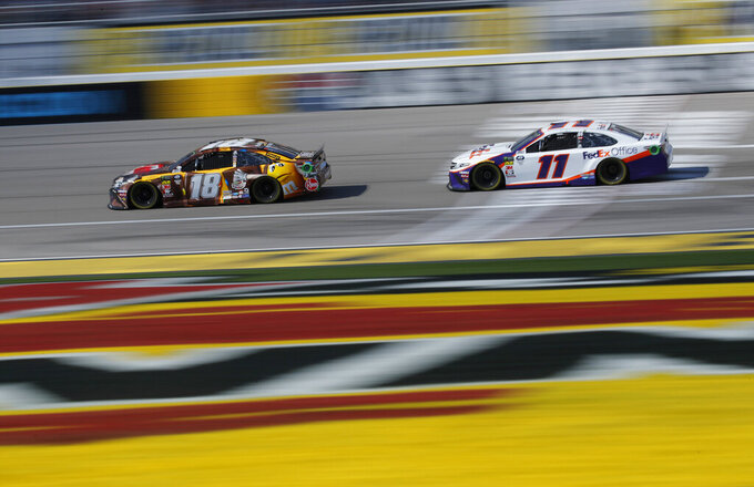 Kyle Busch (18) and Denny Hamlin (11) drive during a NASCAR Cup Series auto race at Las Vegas Motor Speedway, Sunday, March 3, 2019, in Las Vegas. (AP Photo/John Locher)