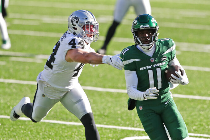 New York Jets' Denzel Mims, right, runs from Las Vegas Raiders' Nick Kwiatkoski during the first half an NFL football game, Sunday, Dec. 6, 2020, in East Rutherford, N.J. (AP Photo/Noah K. Murray)