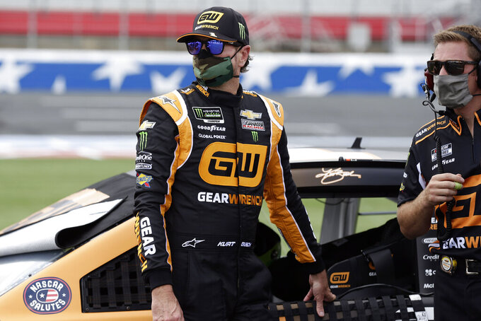 Driver Kurt Busch, left, watches on pit road during qualifying prior to a NASCAR Cup Series auto race at Charlotte Motor Speedway Sunday, May 24, 2020, in Concord, N.C. Busch won the pole position for the race. (AP Photo/Gerry Broome)