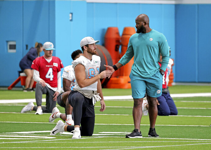 Miami Dolphins tight end Durham Smythe (81) talks with quality control coach Kolby Smith during practice at Baptist Health Training Complex in Hard Rock Stadium on Wednesday, October 20, 2021 in Miami Gardens, Florida, in preparation for their game against the Atlanta Falcons at Hard Rock Stadium on Sunday, October 24.(David Santiago/Miami Herald via AP)