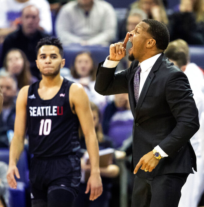 Washington assistant coach Will Conroy gives instructions to his team during the first half of an NCAA college basketball game against Seattle, Tuesday, Dec. 17, 2019, in Seattle. (Andy Bao/The Seattle Times via AP)