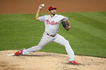 Philadelphia Phillies starting pitcher Zach Eflin winds up during the fourth inning of the team's baseball game against the Washington Nationals, Wednesday, Sept. 23, 2020, in Washington. (AP Photo/Nick Wass)