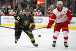Vegas Golden Knights center Jonathan Marchessault (81) and Detroit Red Wings defenseman Filip Hronek stake for the puck during the second period of an NHL hockey game Saturday, March 23, 2019, in Las Vegas. (AP Photo/John Locher)