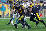 Pittsburgh Steelers running back James Conner (30) rushes for a touchdown during the second half of an NFL football game against the Miami Dolphins in Pittsburgh, Monday, Oct. 28, 2019. (AP Photo/Keith Srakocic)