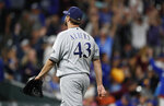 Milwaukee Brewers relief pitcher Matt Albers heads off the mound after giving up a solo walkoff home run to Colorado Rockies' Trevor Story in the 10th inning of a baseball game Saturday, Sept. 28, 2019, in Denver. (AP Photo/David Zalubowski)