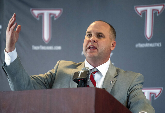 FILE - In this Jan. 11, 2019, file photo, Troy University's new NCAA college football coach Chip Lindsey speaks after he was introduced during a news conference in Troy, Ala. Chip Lindsey and his family were just settling into their new house in Kansas when the call came. Lindsey, who had recently become Les Miles' offensive coordinator at Kansas, moved into the house with his family on Jan. 4 shortly after they joined him in Lawrence. Then Troy called about its head coaching job and he was introduced back in Alabama on Jan. 10, a whirlwind of packing, unpacking and moving even for a well-traveled football coach(Mickey Welsh/The Montgomery Advertiser via AP, File)