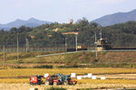 Military guard posts of North Korea, top, and South Korea, center, are seen in Paju, South Korea, near the border with North Korea, Tuesday, Oct. 15, 2019. Amid swine fever scare that grips both Koreas, South Korea is deploying snipers, installing traps and flying drones along the rivals' tense border to kill wild boars that some experts say may have spread the animal disease from north to south. (AP Photo/Ahn Young-joon)WLD