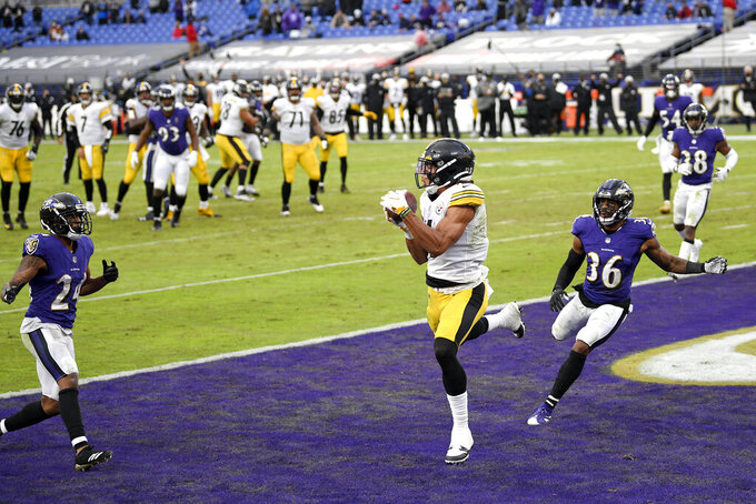 Pittsburgh Steelers wide receiver Chase Claypool, center left, makes a touchdown catch on a pass from quarterback Ben Roethlisberger (7) during the second half of an NFL football game against the Baltimore Ravens, Sunday, Nov. 1, 2020, in Baltimore. (AP Photo/Nick Wass)