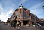 Fans pass by Coors Field during a festival staged by the Colorado Rockies in Coors Field Saturday, Jan. 25, 2020, in Denver. The Rockies are preparing for the opening of spring training. (AP Photo/David Zalubowski)