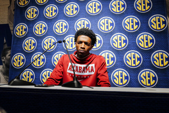Alabama's Herbert Jones speaks during the Southeastern Conference NCAA college basketball media day Wednesday, Oct. 16, 2019, in Birmingham, Ala. (AP Photo/Butch Dill)