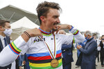 France's Julian Alaphilippe celebrates winning the men's elite event, at the road cycling World Championships, in Imola, Italy, Sunday, Sept. 27, 2020. (AP Photo/Andrew Medichini)