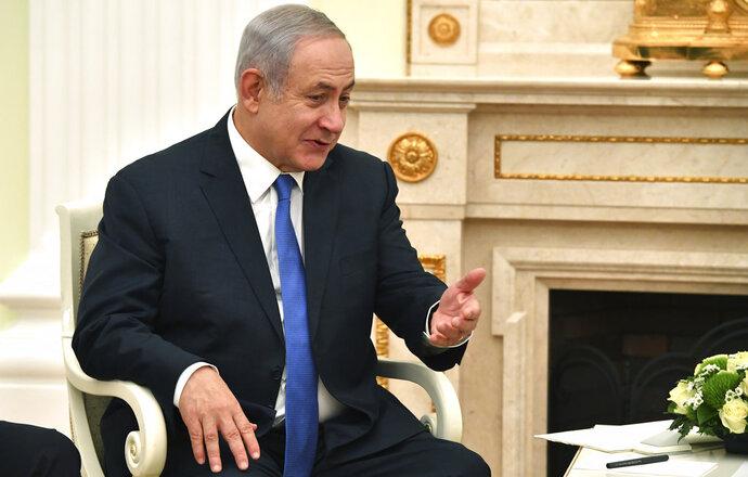 Israeli Prime Minister Benjamin Netanyahu speaks with Russian President Vladimir Putin during their meeting at the Kremlin in Moscow, Wednesday, July 11, 2018. (Yuri Kadobnov/ Pool photo via AP)