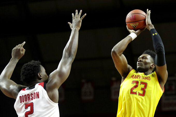 Maryland forward Bruno Fernando (23) shoots over Rutgers center Shaquille Doorson (2) during the first half of an NCAA college basketball game, Saturday, Jan. 5, 2019, in Piscataway, N.J. (AP Photo/Julio Cortez)