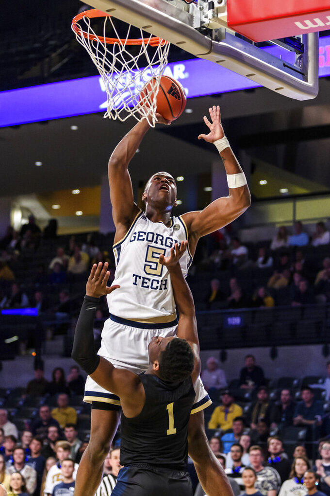 Georgia Tech forward Moses Wright (5) shoots over Pittsburgh guard Xavier Johnson (1) during the first half of an NCAA college basketball game Wednesday, Feb. 20, 2019, in Atlanta. (AP Photo/Danny Karnik)