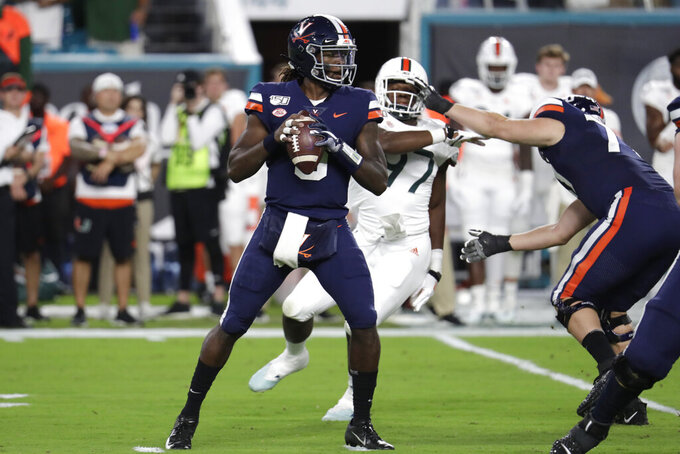 Virginia quarterback Bryce Perkins (3) looks to pass during the first half of an NCAA college football game against Miami, Friday, Oct. 11, 2019, in Miami Gardens, Fla. (AP Photo/Lynne Sladky)