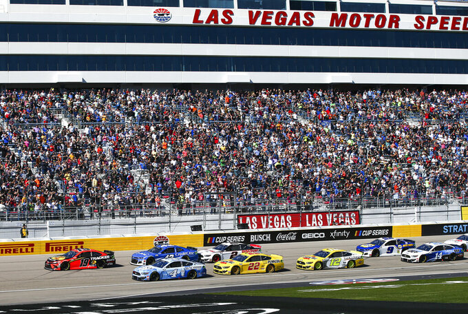 Cars round the track during a NASCAR Cup Series auto race at Las Vegas Motor Speedway on Sunday, Feb. 23, 2020. (AP Photo/Chase Stevens)