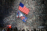 Confetti flies as fans watch the New England Patriots parade through downtown Boston, Tuesday, Feb. 5, 2019, to celebrate their win over the Los Angeles Rams in Sunday's NFL Super Bowl 53 football game in Atlanta. The Patriots have won six Super Bowl championships. (AP Photo/Elise Amendola)