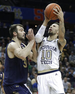 Georgia Tech's Jose Alvarado (10) shoots against Notre Dame's John Mooney (33) during the first half of an NCAA college basketball game in the Atlantic Coast Conference tournament in Charlotte, N.C., Tuesday, March 12, 2019. (AP Photo/Nell Redmond)