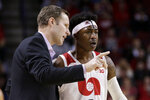 Nebraska coach Fred Hoiberg talks to Cam Mack during the first half of an NCAA college basketball game against Ohio State in Lincoln, Neb., Thursday, Feb. 27, 2020. (AP Photo/Nati Harnik)