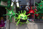 Piñatas depicting the new coronavirus are displayed in a store at Colon park in Guatemala City, Tuesday, April 14, 2020. (AP Photo/Moises Castillo)