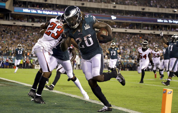 Philadelphia Eagles' Jay Ajayi scores a touchdown during the second half against the Atlanta Falcons in an NFL football game early Friday, Sept. 7, 2018, in Philadelphia. (AP Photo/Matt Rourke)