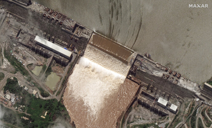 This satellite image shows the Grand Ethiopian Renaissance Dam on the Blue Nile river in the Benishangul-Gumuz region of Ethiopia on Tuesday, July 28, 2020. Ethiopia's prime minister on Wednesday, July 22, 2020 hailed the first filling of the massive dam that has led to tensions with Egypt, saying two turbines will begin generating power next year. (Maxar Technologies via AP)