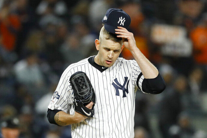 FILE - In this Oct. 18, 2019, file photo, New York Yankees starting pitcher James Paxton reacts after walking Houston Astros' Michael Brantley during the first inning in Game 5 of baseball's American League Championship Series in New York. Paxton has had back surgery and is expected to be sidelined until May or June. (AP Photo/Matt Slocum, File)