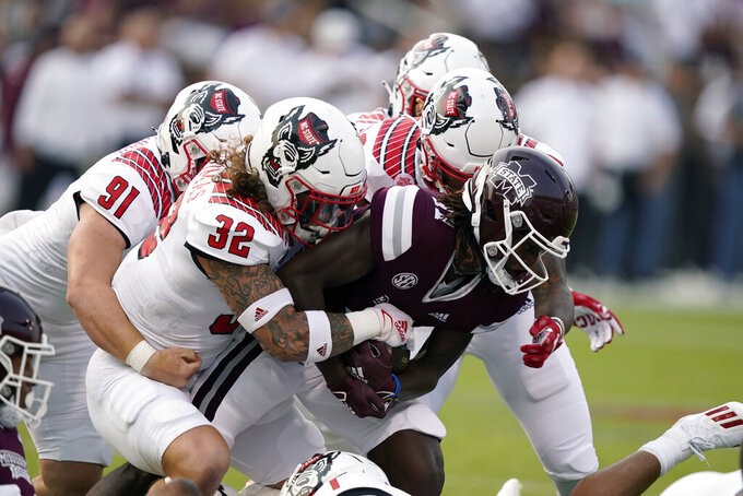 Mississippi State wide receiver Jaden Walley (11) is tackled by North Carolina State linebacker Drake Thomas (32) and other defenders during the first half of an NCAA college football game in Starkville, Miss., Saturday, Sept. 11, 2021. (AP Photo/Rogelio V. Solis)