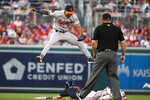 Baltimore Orioles shortstop Richie Martin (1) jumps to catch the throw as Washington Nationals' Trea Turner steals second base during the first inning of a baseball game at Nationals Park Tuesday, Aug. 27, 2019, in Washington. (AP Photo/Alex Brandon)