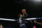 Denver Nuggets guard Jamal Murray (27) puts up a shot during the first half of an NBA basketball game against the Brooklyn Nets on Sunday, Dec. 8, 2019, in New York. (AP Photo/Nicole Sweet)