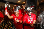 Washington Nationals' Wilmer Difo, left, and Raudy Read celebrate after winning a National League wild-card baseball game against the Milwaukee Brewers, Tuesday, Oct. 1, 2019, in Washington. Washington won 4-3. (AP Photo/Patrick Semansky)