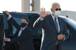 Democratic presidential candidate former Vice President Joe Biden waves as he walks to board his campaign plane at Raleigh-Durham International Airport in Morrisville, N.C., Sunday, Oct. 18, 2020, en route to Wilmington, Del. (AP Photo/Carolyn Kaster)