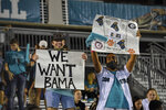 Coastal Carolina fans hold signs during the first half of an NCAA college football game against South Alabama, Saturday, Nov. 7, 2020, in Conway, S.C. (AP Photo/Richard Shiro)