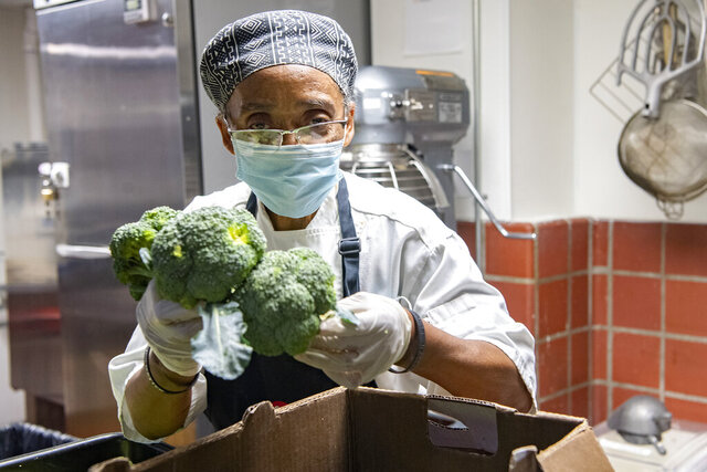 Hanan Shabazz cuts broccoli to prep it for a soup at the Southside Kitchen in Asheville, N.C., Wednesday, Oct. 14, 2020. The staff was feeding about 500 people that day she said. The Southern Foodways Alliance hasawarded Shabazz its annualRuth Fertel Keeper of the Flame Award for her culinary and community work. (Angeli Wright/The Asheville Citizen-Times via AP)