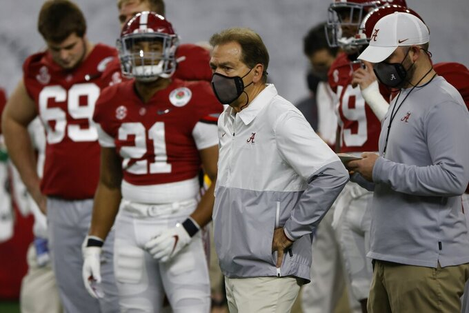 Alabama head coach Nick Saban watches his team warm up before their Rose Bowl NCAA college football game against Notre Dame in Arlington, Texas, Friday, Jan. 1, 2021. (AP Photo/Ron Jenkins)