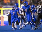 Boise State linebackers Ezekiel Noa (7) and Jabril Frazier (8) celebrate stopping Utah State on a fake punt during the first half of an NCAA college football game Saturday, Nov. 24, 2018, in Boise, Idaho. (Darin Oswald/Idaho Statesman via AP)