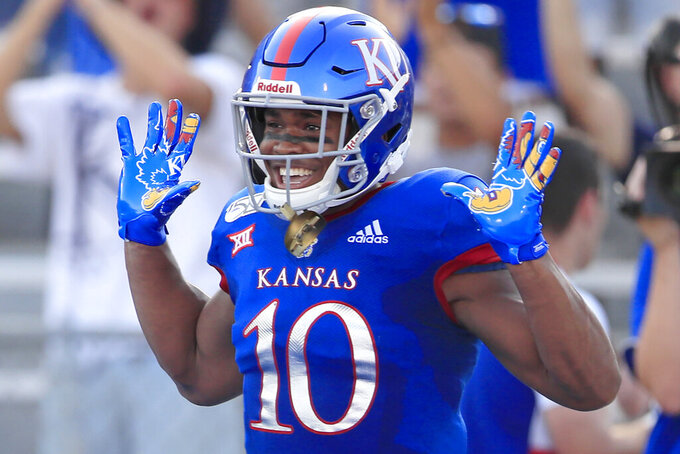 Kansas running back Khalil Herbert celebrates his 41-yard touchdown during the first half of an NCAA college football game against Coastal Carolina in Lawrence, Kan., Saturday, Sept. 7, 2019. (AP Photo/Orlin Wagner)