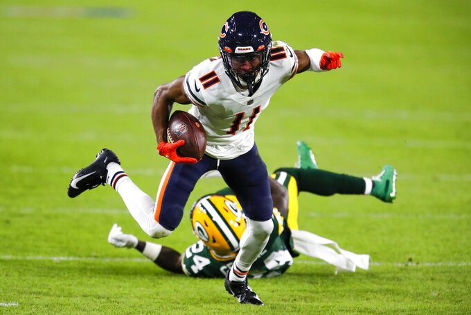 Chicago Bears' Darnell Mooney gets past Green Bay Packers' Raven Greene during the first half of an NFL football game Sunday, Nov. 29, 2020, in Green Bay, Wis. (AP Photo/Matt Ludtke)