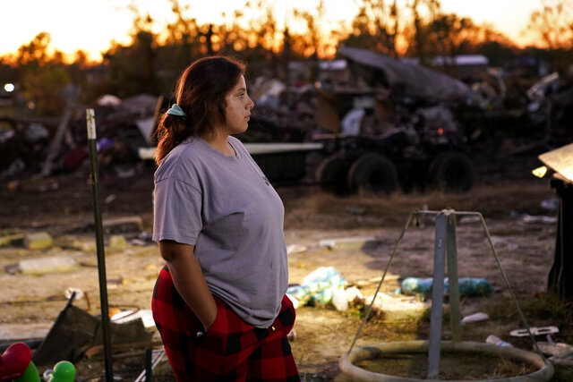 Katelyn Smith watches after her one-year old son Ricky Trahan III, amidst the rubble of the family's destroyed home in Lake Charles, La., Friday, Dec. 4, 2020. They were hit by Hurricanes Laura and Delta. Her future in-laws are living in a tent on the property, while she, her child and her fiancé Ricky Trahan, Jr., are living in a loaned camper. A relatives home on the same property is now gutted and they are living in a camper as well. (AP Photo/Gerald Herbert)