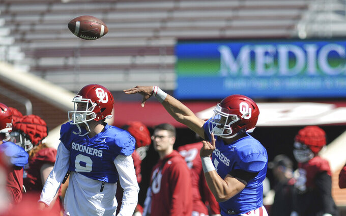 Oklahoma quarterback Jalen Hurst throws during practice in Norman, Okla., Monday, April 1, 2019. (Kyle Phillips/The Norman Transcript via AP)