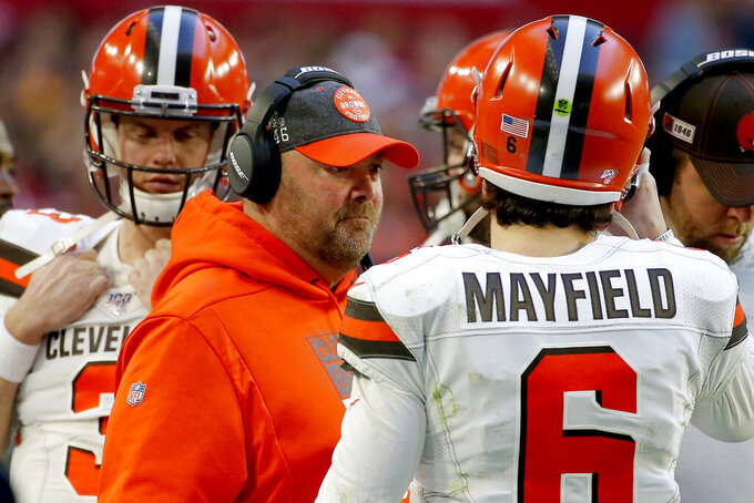 Cleveland Browns head coach Freddie Kitchens talks with quarterback Baker Mayfield (6) during the second half of an NFL football game against the Arizona Cardinals, Sunday, Dec. 15, 2019, in Glendale, Ariz. (AP Photo/Rick Scuteri)