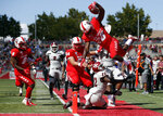 New Mexico running back Ahmari Davis (28) jumps over New Mexico State defensive back Shamad Lomax (22) as he is forced out of bounds near the goal line during the first half of an NCAA college football game on Saturday, Sept. 21, 2019 in Albuquerque, N.M. (AP Photo/Andres Leighton)